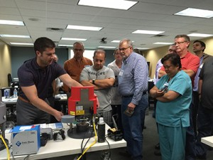 Anastasios Zervos, Dentsply Raintree Essex Rep demonstrating how to use the Drufomat Scan Pressure Machine