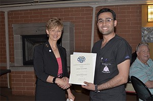 UIC COD DMD AS Second Place Winner, Ali Al Mustafa with Dr. Cheryl Mora