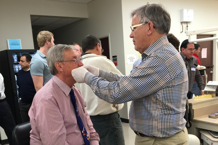 Dr. James Metz and Dr. Jim Day-fitting an anterior bite splint