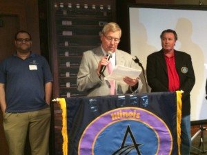 Dr. Robert Kozelka, IL AGD Regional Director reading the Oath of Office
