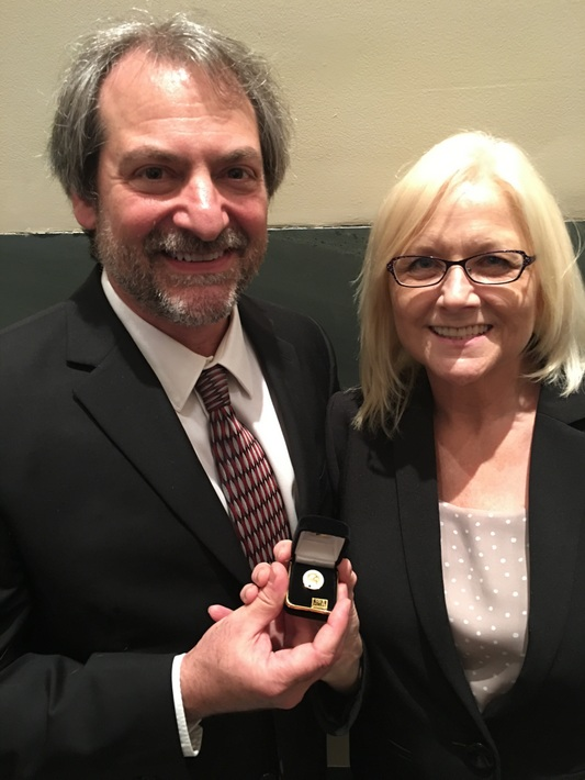 Dr. Steve Petras & his wife, Jaime with his LLSR Pin