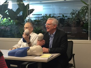 Drs. William Wax and William Lawley reviewing CPR on babies