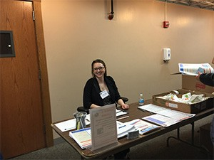 Cassie Mora, Pre-Dental Student UIC COD assisting with registration